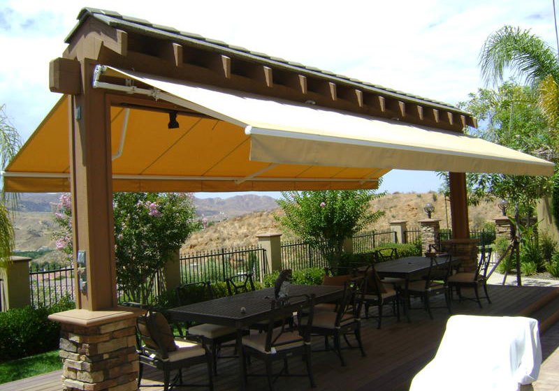 Awnings photo gallery fixed retractable commercial for Colorado shade sail