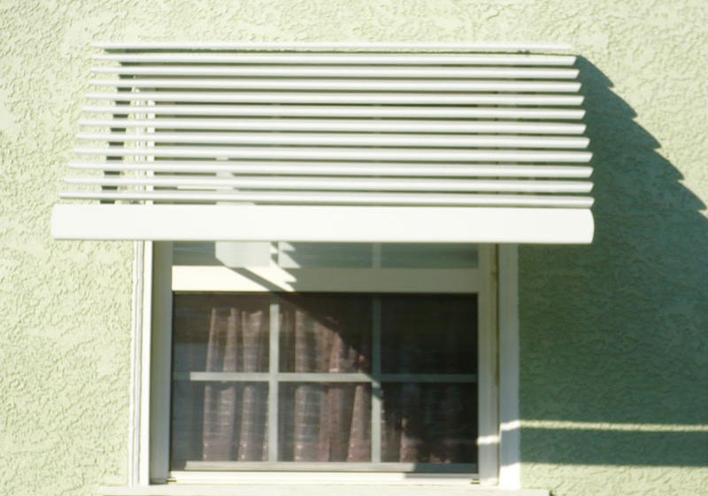 Awnings photo gallery fixed retractable commercial for Pictures of awning windows